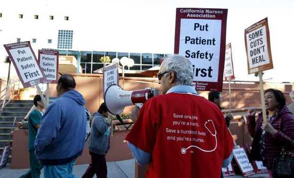 California Nurses Association members, techs and other staff protest planned layoffs in front of Glendale Memorial Hospital early in the morning on Thursday, January 31, 2013.