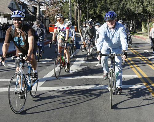 Bicyclists ride on Marengo Avenue.