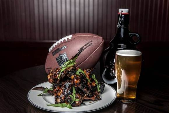 Super Bowl specials around town include stout-glazed chicken wings and growlers of ESP Noble Ale at Casey Lane's Parish downtown.
