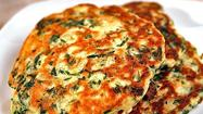 "Who says pancakes are just for breakfast? These savory pancakes from <a href=""http://www.ottolenghi.co.uk/"">Yotam Ottolenghi</a> get their flavor from a colorful blend of spinach, green onions, cumin and serrano chile. Round out the harmony with a pat of lime butter spiced with cilantro, garlic and chile flakes, and you can call it a meal any time of the day. The whole dish comes together in less than an hour."