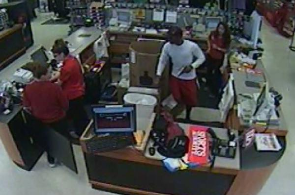 Detectives are looking for an armed robber who pulled a gun from his purse during two hold ups in Deerfield Beach