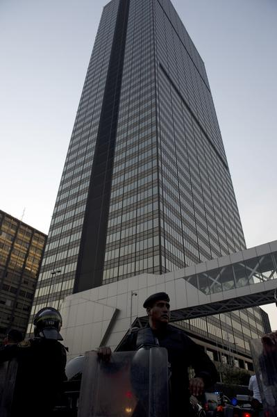 Police officers block off the premises of the skyscraper that houses the headquarters of state-owned Mexican oil giant Pemex in Mexico City after a an explosion.