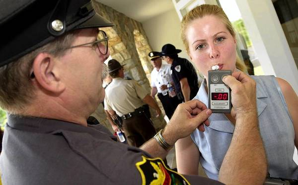 An officer tests a breathalizer in this file photo. State police in Lehigh and Northampton counties tend to use the county DUI testing facilities, which draw blood for testing.