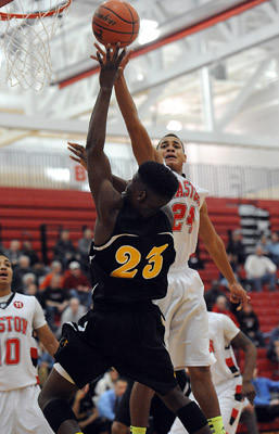 Easton's Ezra Gaines (right) blocks a shot by Freedom's David Williams (left) during their Lehigh Valley Conference boys basketball game Thursday night.