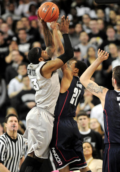 UConn's Omar Calhoun blocks a shot by Providence's LaDontae Henton late in the second half. Calhoun had 13 points in the game.