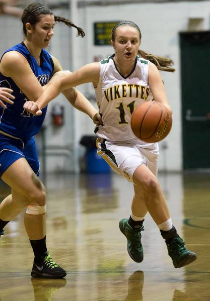 Central Catholic's Alyssa Mack drives in against Southern Lehigh's Melann Amory in their girls high school basketball game in Allentown on Monday December 17, 2012.