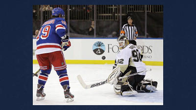 New York Rangers center Brad Richards (19) watches as Pittsburgh Penguins goalie Tomas Vokoun (92), of the Czech Republic, makes a save in the second period of their NHL hockey game Thursday in New York.