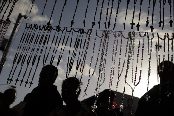 Rosaries are seen hanging at a street stall during the annual procession of Saint John Bosco in Panama City January 31, 2013. Saint John Bosco is known in Panama as the Patron of Youth and is remembered for his lifelong dedication to educate, guide and rescue the young from vice and poverty.