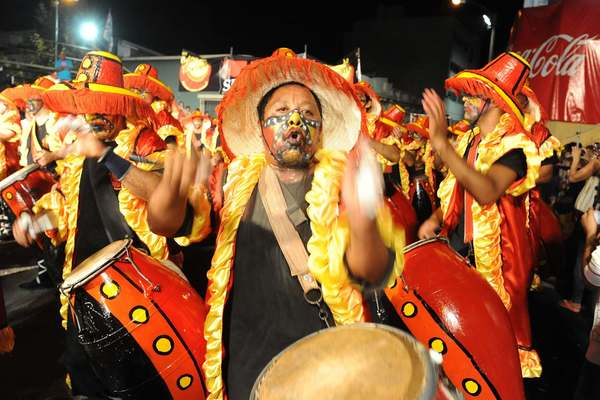 "Drummers perform during the first day of the ""Llamadas"", one of the carnival parades taking place in Montevideo, on January 31, 2013. The ""Llamadas"" is Uruguay's biggest carnival parade during which the ""comparsas"" -traditional ""candombe"" music groups of dancers and drummers- compete during two days."