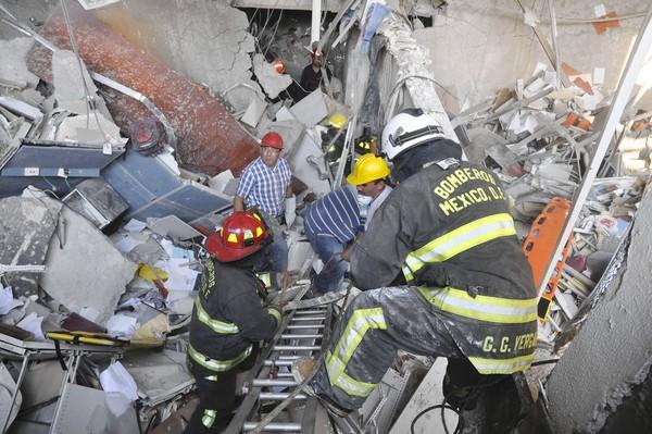 Rescuers search for survivors after an explosion rocks the headquarters of Pemex, Mexico's state oil giant, in Mexico City.