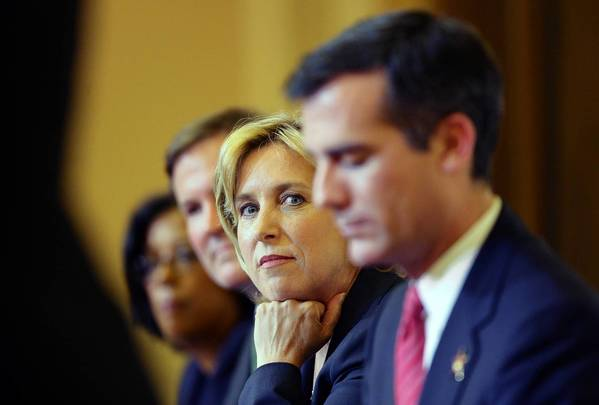 Los Angeles mayoral candidates Wendy Greuel, second from right, and Eric Garcetti, right, have ramped up their attacks on one another.