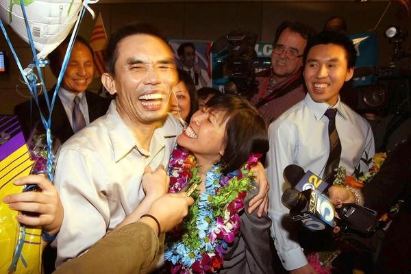 Nguyen Quoc Quan reunites with his wife, Huong Mai Ngo, center, and son Khoa Nguyen, right, at Los Angeles International Airport.