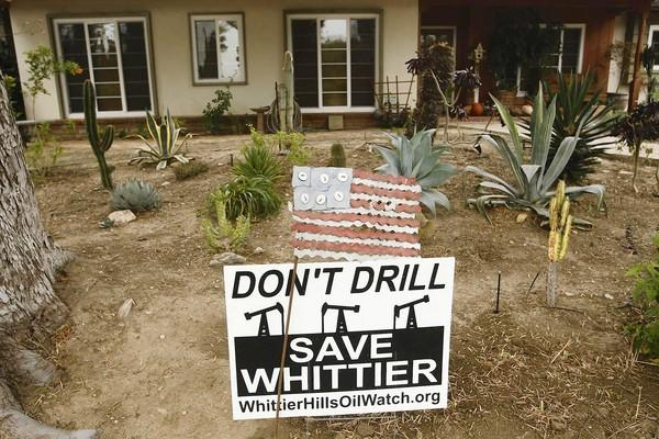 A sign at a home next to Whittier's nature preserve protests the oil drilling plans.