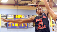 30-second timeout with ... Lavon Long, Oakland Mills boys basketball forward