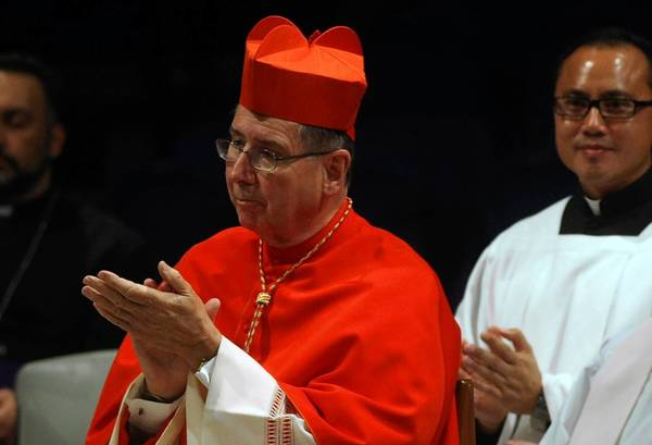 Cardinal Roger M. Mahony applauds during the December installation of Kevin W. Vann as bishop of the Diocese of Orange County. The public censure of Mahony, one of the most powerful men in the Catholic Church, was unparalleled, experts said.