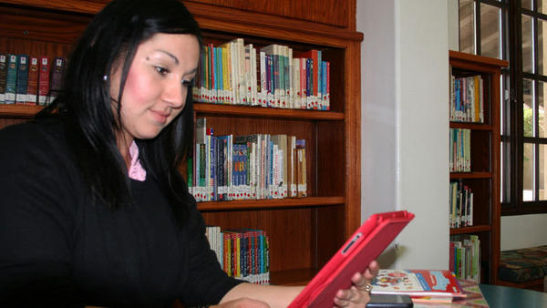 Veronica Hinojosa browses the Internet on an iPad while at the Brawley Public Library on Thursday evening.