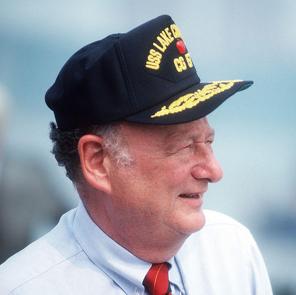 Edward I. Koch, mayor of New York City, sports a sailor's cap at the commissioning ceremony for the guided missile cruiser USS LAKE CHAMPLAIN.