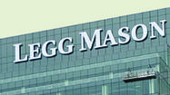 Legg Mason Inc. reported Friday a $453.9 million loss for the third quarter, following a previously announced $734 million writedown of certain assets.