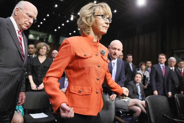 Former Rep. Gabrielle Giffords and husband Mark Kelly, right, arrive for the Senate Judiciary Committee hearing on gun control, where both testifed.