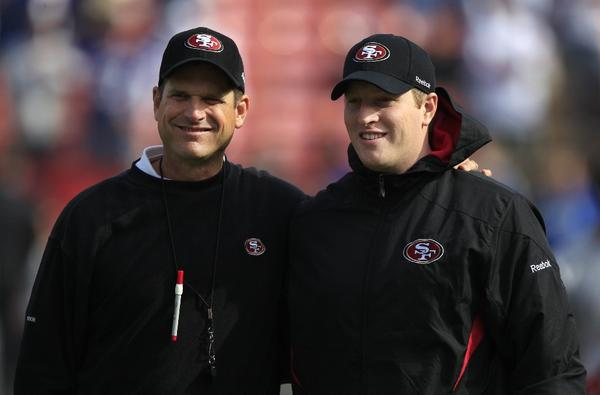 San Francisco 49ers head coach Jim Harbaugh, left, and his son Jay are shown before an NFL football game against the New York Giants in 2011.