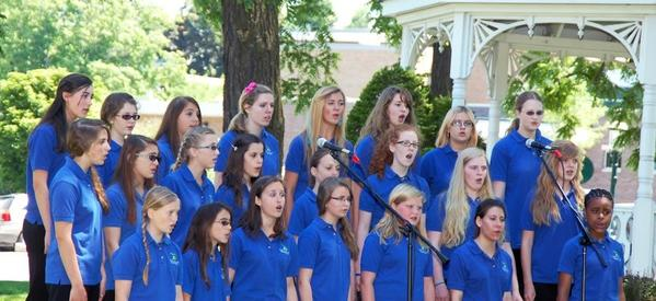 The Little Traverse Youth Choir performs an outdoor concert last summer. The young singers will entertain diners at the Thursday, Feb. 7, Petoskey Rotary Spaghetti Dinner.