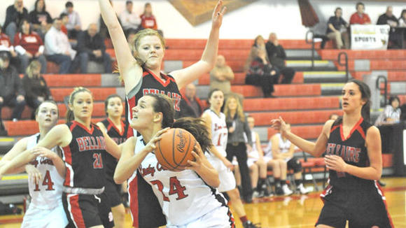 J-L senior Hannah Huff battles in the post during the Lady Cards' 46-31 victory against Bellaire Tuesday.