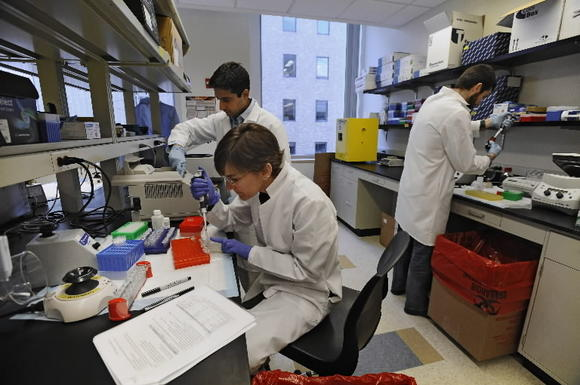 Researchers at Personal Genome Diagnostics at work. The company spun off from Johns Hopkins.