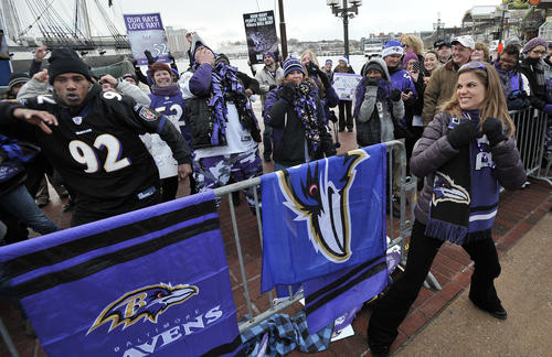 """Mike Dais, left, of Baltimore, and Natalie Morales, a """"Today Show"""" anchor, rehearse Baltimore Ravens linebacker Ray Lewis' dance during a Ravens rally at the Inner Harbor."""