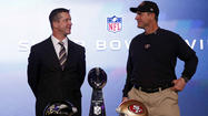 Ravens coach John Harbaugh and 49ers coach Jim Harbaugh held a joint news conference Friday morning at the New Orleans Convention Center, ending the session by posing for pictures with their family and the Lombardi Trophy, though neither coach touched the trophy.