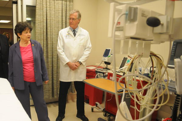 Boca Raton Regional Hospital Vice President and Chief Nursing Officer Melissa Durbin (left) shows American College of Emergency Physicians board chairman Dr. Andrew I. Bern, U.S. Rep. Lois Frankel and Emergency Medicine Dr. Terry B. Cohen (right) one of the emergency rooms with the capability to respond to stroke patients using advanced medical procedures.