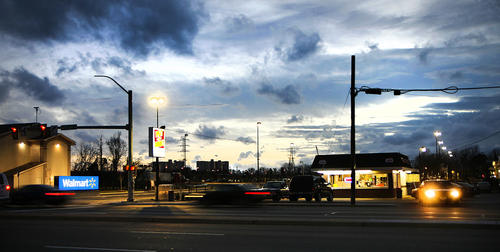 The color of a warm winter evening sky provides a stunning backdrop for the What-A-Burger which now shares a Jefferson Ave. entrance with a new Wal-Mart.