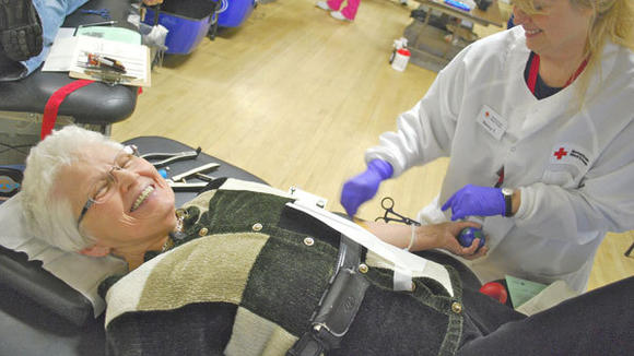 Geri Troglin, of Gaylord, smiles as Nancy Topel (r) collects Troglin¿s 99th pint of blood Wednesday during a drive sponsored by the Gaylord Herald Times and RSVP.