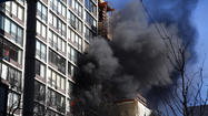 An extra-alarm fire at a Near North Side high-rise building was largely confined to the unit where it started because the apartment's resident remembered to close the door after fleeing the fire, according to the Chicago Fire Department.