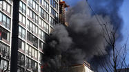A fire burns in a Near North high-rise this morning.  Keri Wiginton, Chicago Tribune