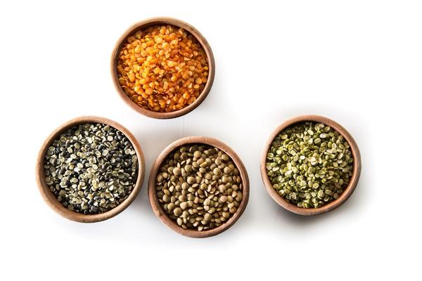 From left, Small brown lentils, and Green Moong split, and red split lentils, above.