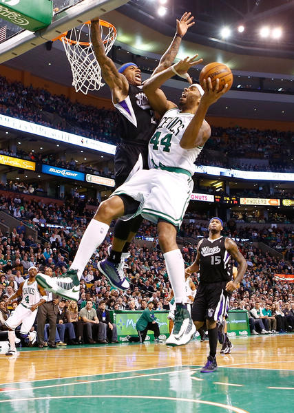 Chris Wilcox #44 of the Boston Celtics goes up for a layup in front of Isaiah Thomas #22 of the Sacramento Kings during the game on January 30, 2013 at TD Garden in Boston, Massachusetts.