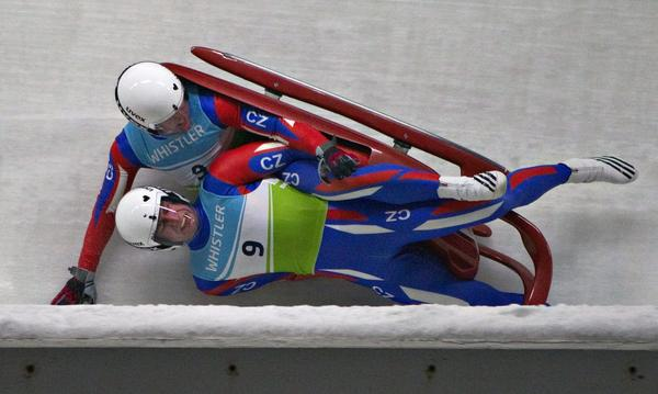 Czech Republic's Matej Kvicala (R) and Jaromir Kudera fall off their sled during training for the Luge World Championship training in Whistler, British Columbia January 31, 2013. Neither one was seriously injured.