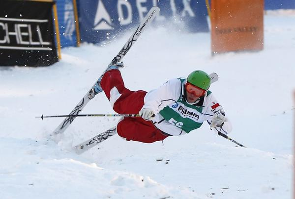 Colin Lang of Poland crashes during the men's mogul qualifications event at the FIS World Cup Freestyle skiing competition in Park City, Utah, January 31, 2013.