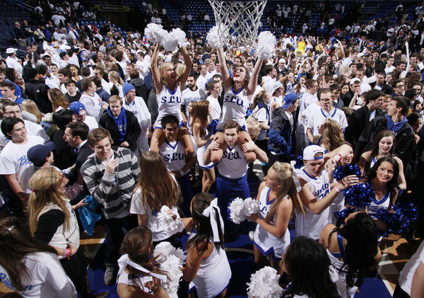 Fans flood the court after Saint Louis' 75-58 upset of Butler at Chaifetz Arena in St. Louis, Missouri, on Thursday, January 31, 2013.