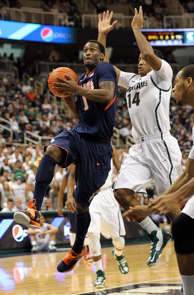 Illinois Fighting Illini guard D.J. Richardson (1) drives to the basket against Michigan State Spartans guard Gary Harris (14) during 1st half at Jack Breslin Students Events Center.
