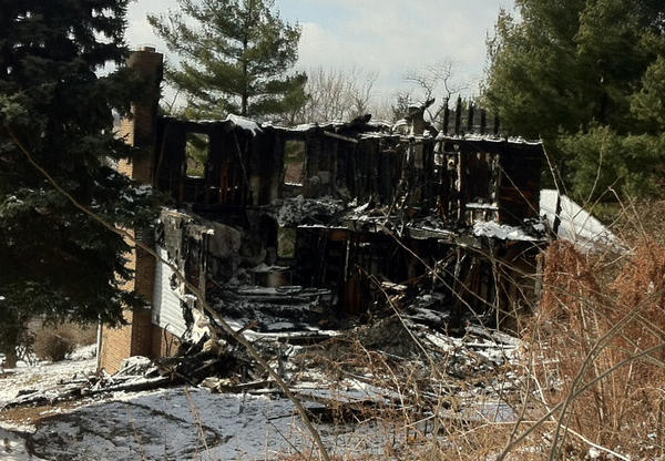 The charred remains of a home on Highland Avenue in Myersville, Md., where two young girls died and five people were injured in a fire that broke out Thursday night.