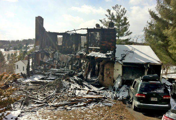 Two young girls died and five other people were injured when fire destroyed this home on Highland Avenue in Myersville, Md., Thursday night.