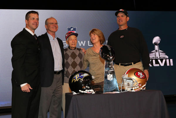 Baltimore Ravens head coach John Harbaugh (left) poses for a photo with San Francisco 49ers head coach Jim Harbaugh (right) and father Jack Harbaugh (second from left) , grandfather Joe Cipiti (middle) and mother Jackie Harbaugh.