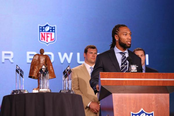 "Cardinals receiver Larry Fitzgerald speaks during the Walter Payton NFL ""Man of the Year"" press conference. The award is presented annually to a player who has demonstrated a dedication to volunteer and charity work in addition to on-field excellence. Fitzgerald is a finalist for the award along with Cowboys tight end Jason Witten and Browns lineman Joe Thomas."