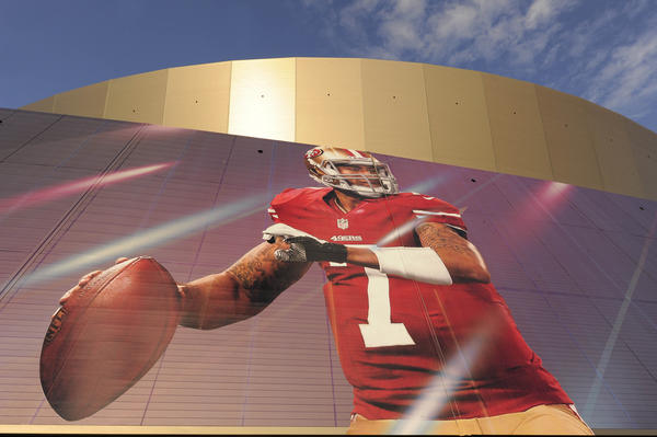 An ground-up view of of the banner featuring 49ers quarterback Colin Kaepernick on the Mercedes-Benz Superdome.