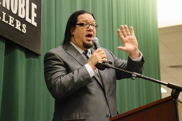 "Penn Jillette signs copies of his new book ""Every Day Is An Atheist Holiday"" at Barnes & Noble Tribeca on Nov. 14, 2012, in New York City."