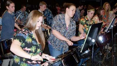 Members of the Petoskey High School Steel Drum Band rehearse Thursday in the Petoskey Middle School auditorium.