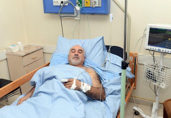 Armenian presidential candidate Paruyr Hayrikyan rests at the Surb Grigor Lusavorich Medical Center in Yerevan.