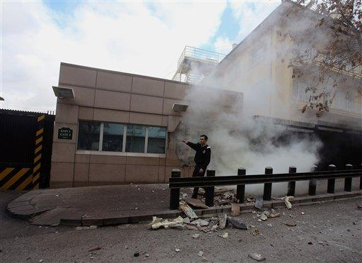 An embassy security guard asks for help minutes after a suicide bomber detonated an explosive device at the entrance of the U.S. Embassy in Ankara, Turkey on Friday.