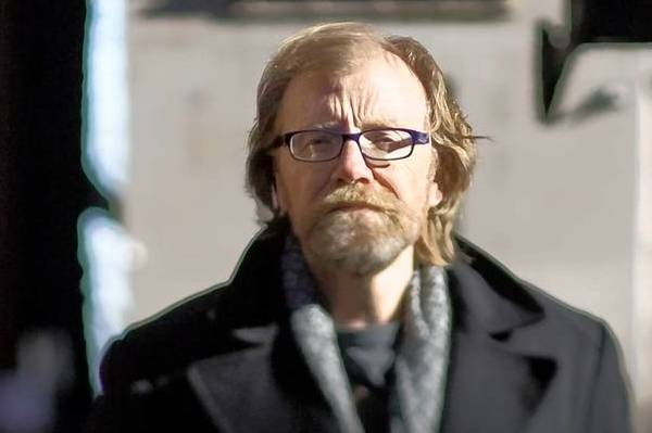 Noted author George Saunders is photographed on Gold Coast streets in Chicago.